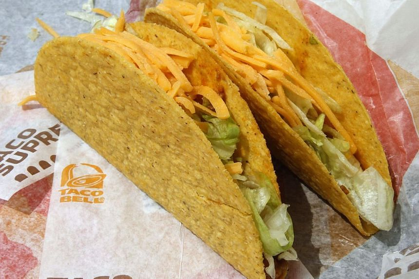 US health officials hope Americans will think twice about tucking into fast foods such as these two crunchy tacos at a Taco Bell restaurant in Glendale, Calif when the calorie count is staring them in the face from the menu under sweeping new rules a