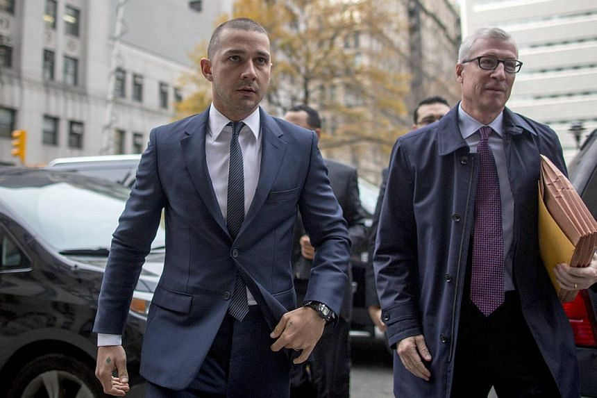 Actor Shia LaBeouf (left) arrives at the Manhattan Criminal Courthouse in New York on Nov 25, 2014. LaBeouf was there to show he is in compliance with a treatment programme after he pleaded guilty in September to a disorderly conduct violation for di