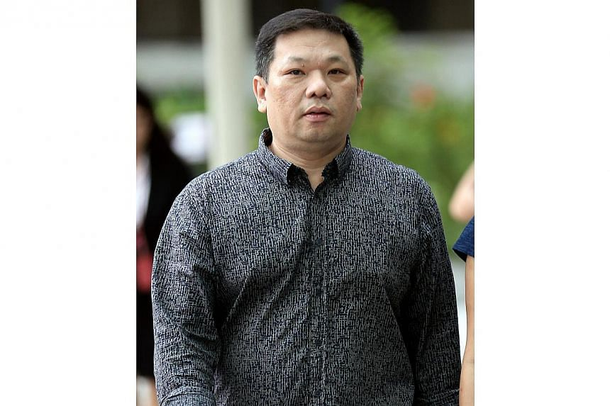 Tan Tee Wee,who wed his long-time girlfriend overseas when he was still married, was sentenced to two months in jail for bigamy on Wednesday. -- ST PHOTO:WONG KWAI CHOW