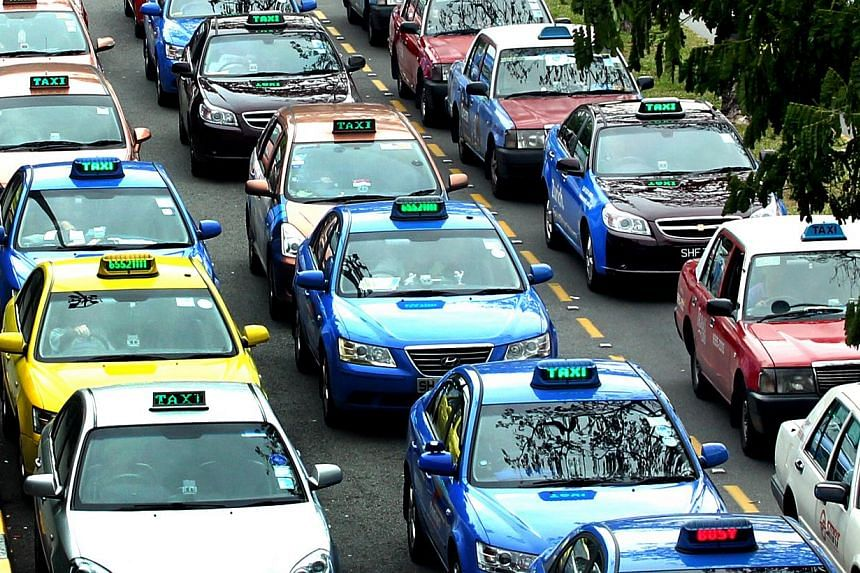 At least 85 per cent of taxi operators' fleets will have to meet a daily minimum mileage of 250km on weekdays, and during the peak periods, 85 per cent of their taxis must also be on the roads. -- ST PHOTO: CHEW SENG KIM