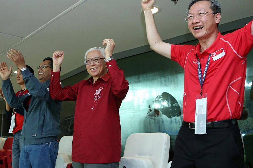Singapore President Tony Tan and MCCY Minister of State Sam Tan (right) cheering on the Lions during their AFF Suzuki Cup clash against Myanmar at the National Stadium. -- PHOTO: MCI