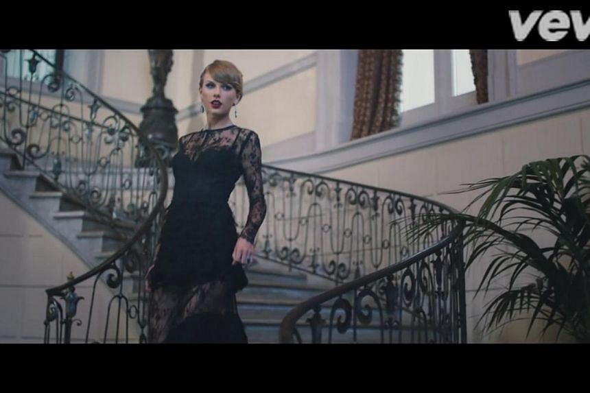 Taylor Swift is better known for her girl-next-door looks, but she exuded sensuality in this see-through lace gown.-- PHOTO: TAYLOR SWIFT/YOUTUBE