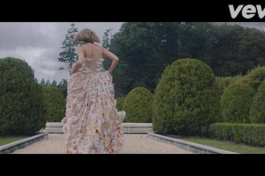 The floral appliques on the dress add an air of romance and gives the dress a life of its own.-- PHOTO: TAYLOR SWIFT/YOUTUBE