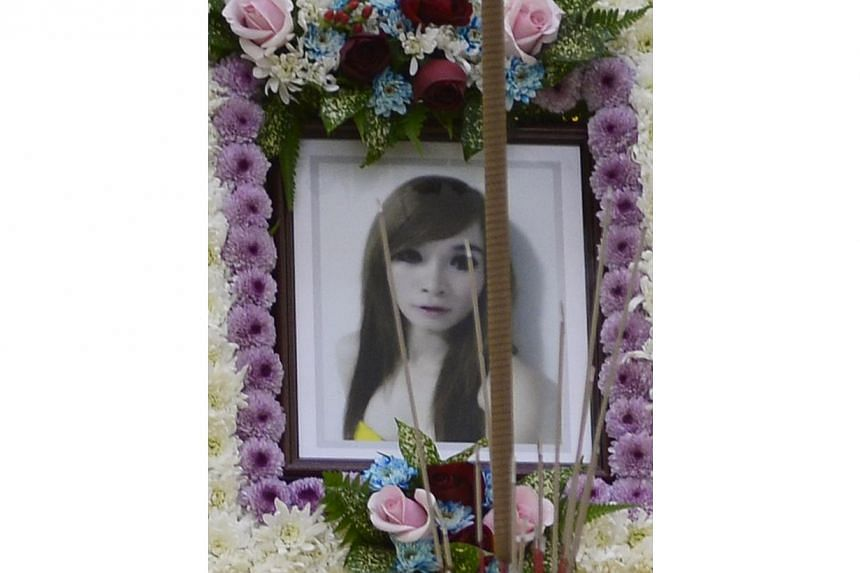 A portrait of the late Tran Cam Ny, a 32-year-old Vietnamese woman who was murdered in an Ang Mo Kio flat on Nov 20, 2014, at her wake on Nov 26, 2014. -- ST PHOTO: MARK CHEONG