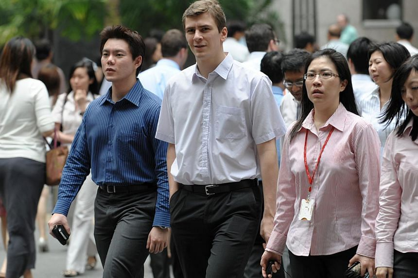 Guidelines have been drawn up to help employers and unions prepare for a change in the law to allow for more union representation of white-collared workers. -- PHOTO: ST FILE
