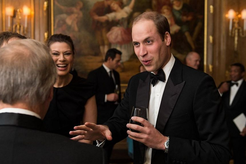 Britain's Prince William, Duke of Cambridge (right) talks with guests at the Tusk Conservation Awards event at Claridges Hotel in London on Nov 25, 2014.Prince William will go to China early next year in the first visit to the mainland by a mem