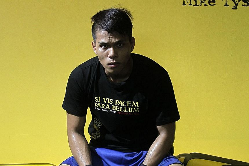 Singapore boxer Shahril Salim at the Juggernaut Fight Club on Oct 20, 2012. He died on Thursday,two years after a collapse during training left him with a serious brain injury.-- ST PHOTO: KEVIN LIM