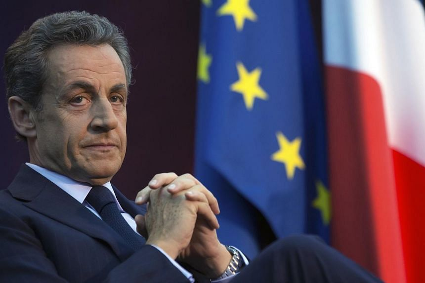 Former French President Nicolas Sarkozy attends a political rally as he campaigns for the leadership of the UMP political party in Boulogne-Billancourt, Paris suburb, on Nov 25, 2014. France's ex-president is limbering up for his potential springboar