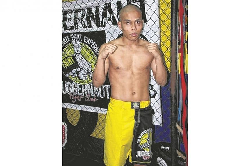 Local boxer Shahril Salim at the Juggernaut Fight Club in Boat Quay. -- PHOTO: JUFRI SALIM