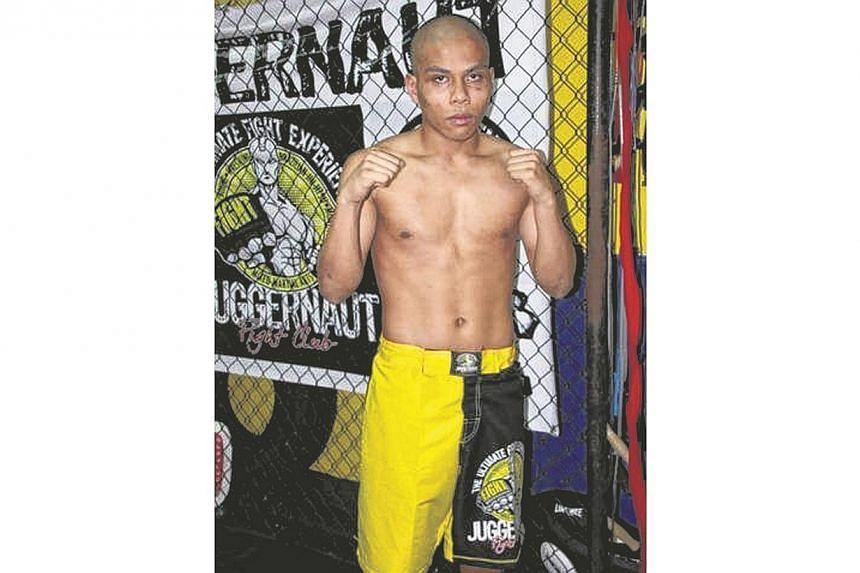 Local boxer Shahril Salim at the Juggernaut Fight Club in Boat Quay. -- PHOTO: JUFRI SALIM