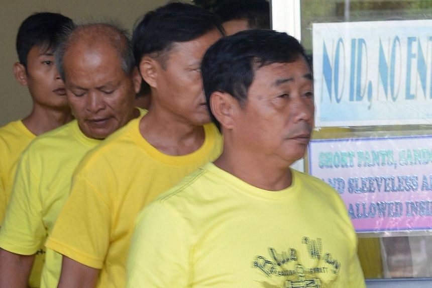 A group of Chinese fishermen leave a court in Puerto Princesa, Palawan island on Nov 24, 2014, after they were found guilty of poaching.Nine Chinese fishermen convicted this week of poaching by a Philippine court will be released and deported o