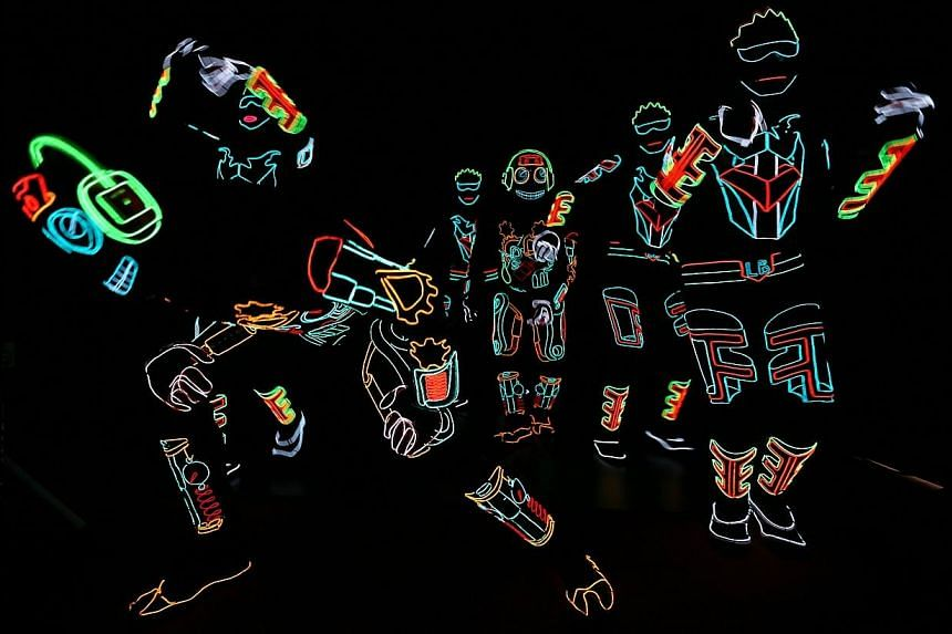 Light Balance, Britain's Got Talent (2014) semi-finalists, performs for shoppers at the basement atrium of Parkway Parade as part of the mall's line up of Christmas events and activities. -- ST PHOTO: NEO XIAOBIN