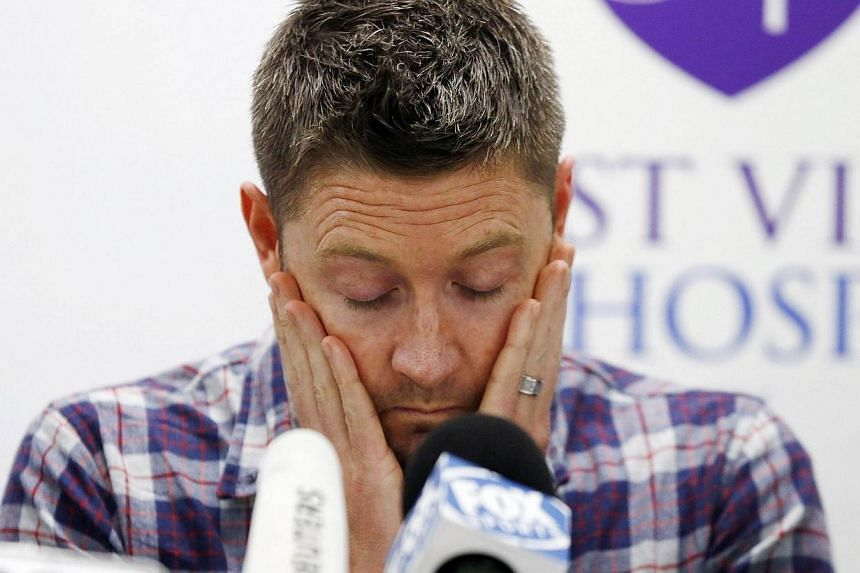 Australian cricket captain Michael Clarke pauses before delivering a statement, on behalf of the family of deceased teammate Phillip Hughes, at St Vincent's Hospital in Sydney on Nov 27, 2014. -- PHOTO: REUTERS