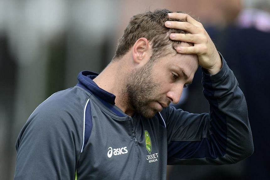 Australia's Phillip Hughes touches his head during a training session in Manchester on July 30, 2013. -- PHOTO: REUTERS