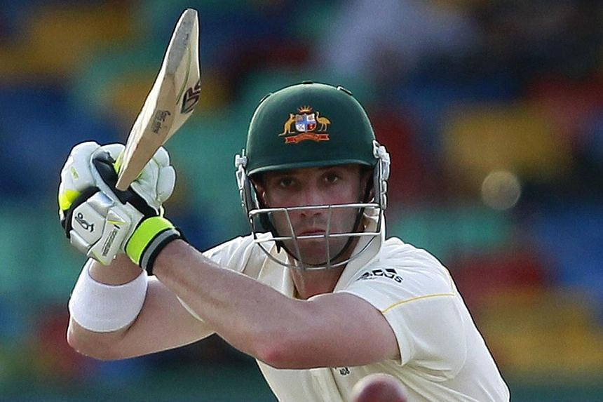 Australia's Phillip Hughes watches his shot during the fourth day of their third and final test cricket match against Sri Lanka in Colombo on Sept 19, 2011. -- PHOTO: REUTERS