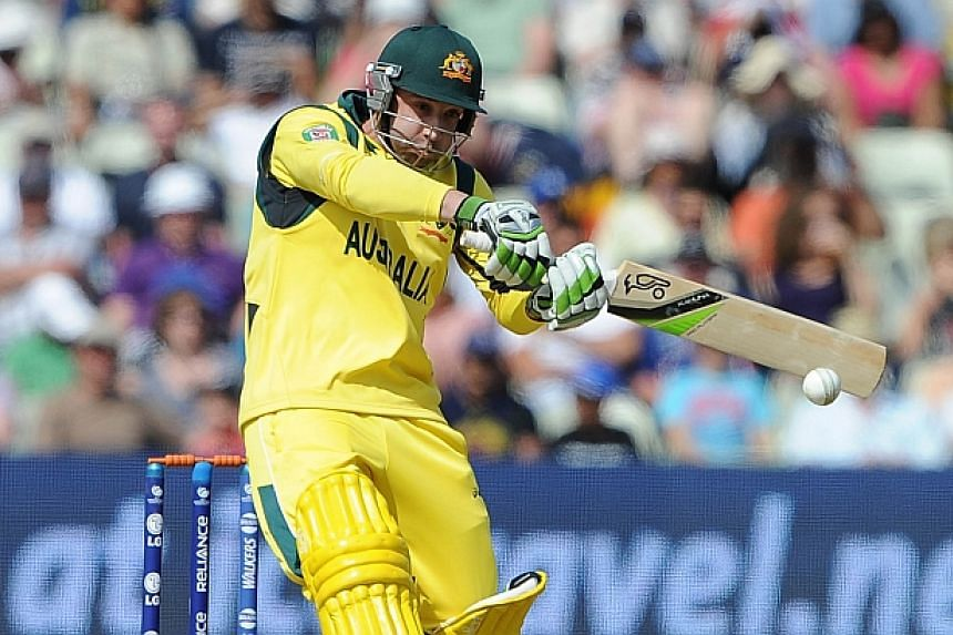 Australian batsman Phillip Hughes bats during the 2013 ICC Champions Trophy cricket match between England and Australia at Edgbaston in Birmingham, central England on June 8, 2013. -- PHOTO: AFP