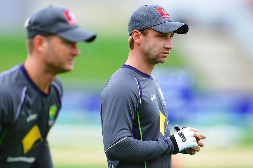 Australia's player Phil Hughes (right) with captain Michael Clarke (left) during a training session ahead of the first cricket Test match between Australia and Sri Lanka in Hobart on Dec 13, 2012. -- PHOTO: AFP