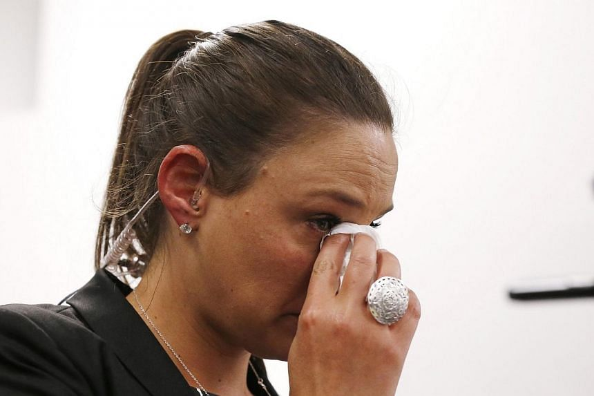 A television journalist wipes a tear away during a news conference by St Vincent's Hospital medical staff and Australian cricket representatives on the death of Australian cricketer Phillip Hughes in Sydney on Nov 27, 2014. -- PHOTO: REUTERS