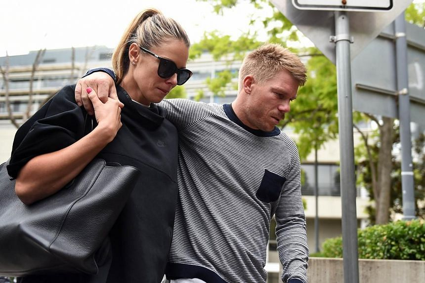 Australian batsman David Warner (right) and his wife Candice Falzon (left) leave St Vincent's Hospital following the death of fellow Australian batsman Phillips Hughes in Sydney on Nov 27, 2014. -- PHOTO: AFP