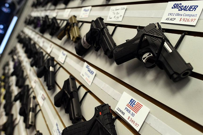 Handguns are displayed at the Ultimate Defence Firing Range and Training Centre in St Peters, Missouri, some 32km west of Ferguson, on Nov 26, 2014. -- PHOTO: AFP