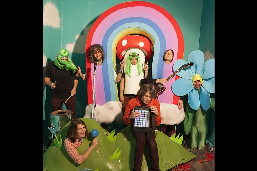 The Flaming Lips with their bizarre props and trippy colours (clockwise from top left) Nicholas Ley, Wayne Coyne, Matt Duckworth, Derek Brown, Michael Ivins, Steven Drozd and Jake Ingalls. -- PHOTO: GEORGE SALISBURY