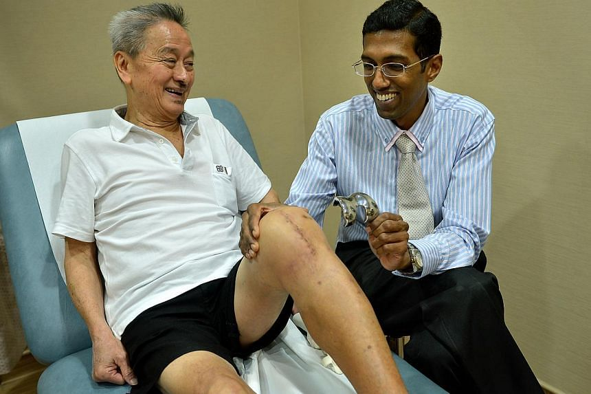 Dr Sathappan with his patient, retiree Wong Took Lim, who underwent surgery last month for a custom implant for his left knee. Custom implants are moulded to give the perfect fit using 3-D printing technology.