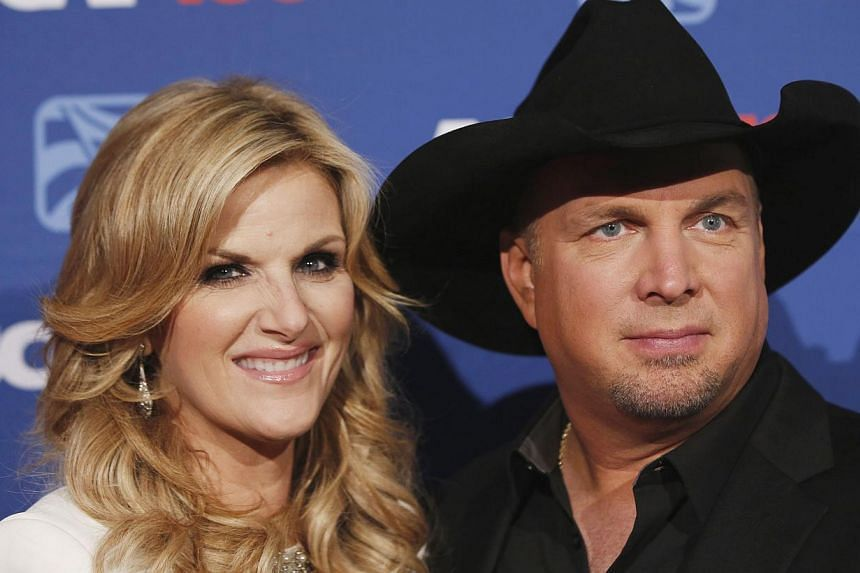 Country music star Garth Brooks (above, with wife Trisha Yearwood) cancelled scheduled media appearances this week, saying it would be in poor taste to promote his comeback album during national protests after a grand jury did not indict a white poli