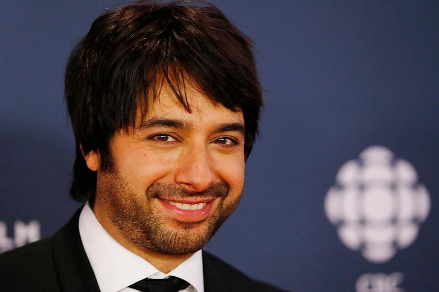 Former syndicated radio hostJian Ghomeshi arrives on the red carpet at the 2014 Canadian Screen awards in Toronto in this file photo from March 9, 2014. Ghomeshi, at the heart of one of Canada's biggest sex scandals, has been charged with sexua