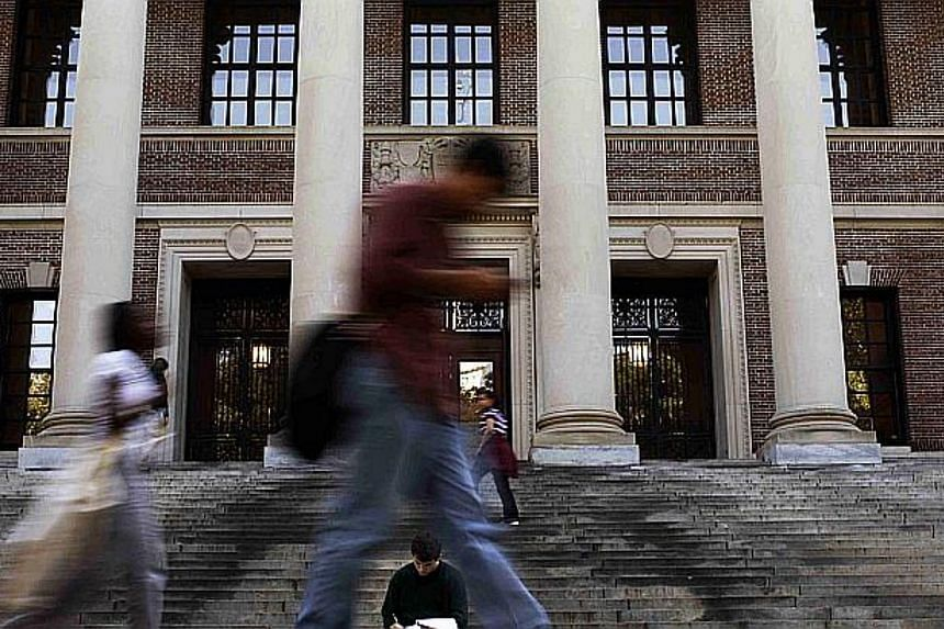 Students at the steps of Widener Library at Harvard University in Cambridge, Massachusetts. --PHOTO: REUTERS