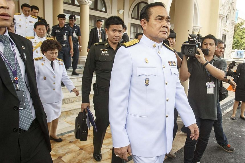 Thailand's Prime Minister Prayuth Chan-ocha leaves Government House as he leads a new cabinet to an audience with King Bhumibol Adulyadej at Siriraj Hospital in Bangkok on Sept 4, 2014. -- PHOTO: REUTERS