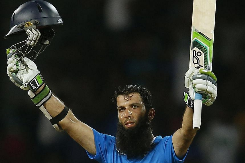 England's Moeen Ali celebrates his century during their first One Day International cricket match against Sri Lanka in Colombo Nov 26, 2014. -- PHOTO: REUTERS