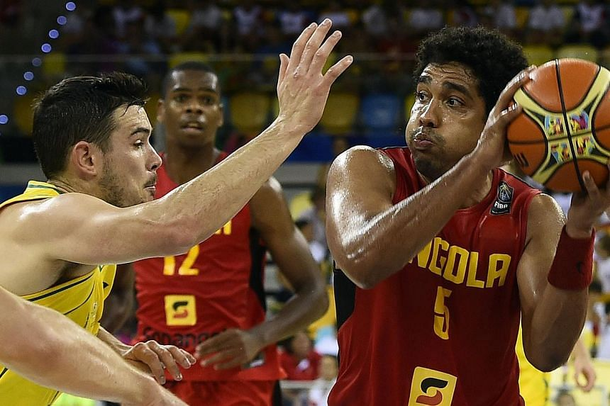 Australia's guard Chris Goulding (left) vies with Angola's guard Armando Costa during the 2014 FIBA World basketball championships on Sept 4, 2014. Australia have been cleared of throwing a World Cup match against Angola, the International Basketball