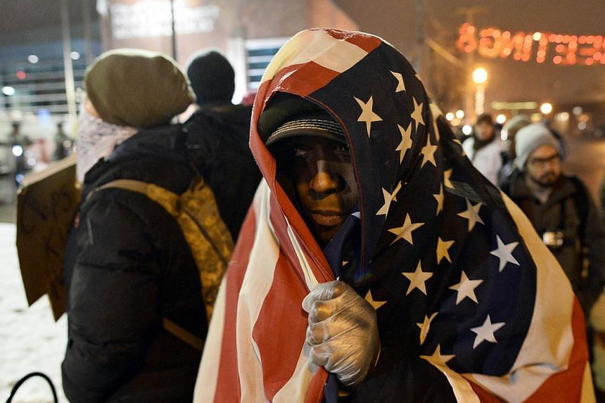 Protesters shout slogans at an intersection in Ferguson, Missouri, on Nov 26, 2014. -- PHOTO: AFP