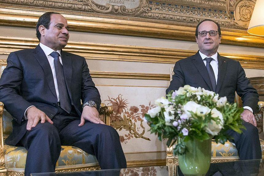 French President Francois Hollande (right) meets his Egyptian counterpart Abdel Fattah al-Sisi at the Elysee presidential palace in Paris on Nov 26, 2014. Sisi began a two-day trip to France, the second leg of a first European tour aimed at bringing
