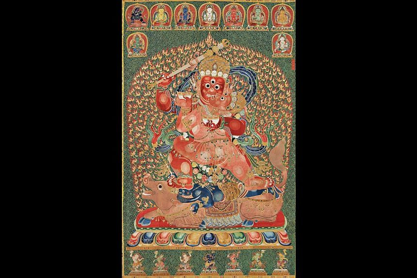 The 600-year-old Tibetan silk tapestry thatset a world record for Chinese art after it was sold to a Shanghai tycoon for US$45 million (S$56 million) at auction in Hong Kong.-- PHOTO: AFP/CHRISTIES
