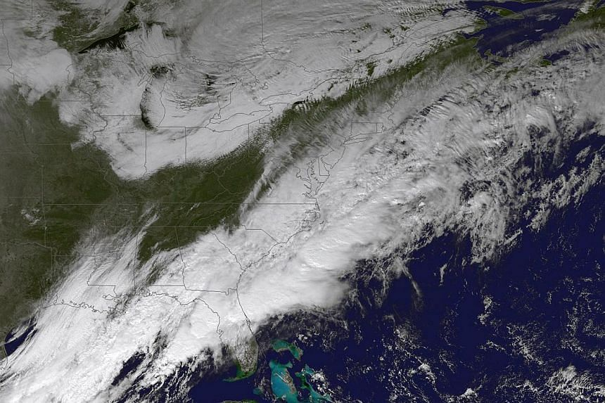 A National Oceanic and Atmospheric Administration image from Nov 25, 2014 shows a weather pattern set to impact the US East Coast.Hundreds of flights were cancelled or delayed on Wednesday in the US north-east as a winter storm delivered freezi