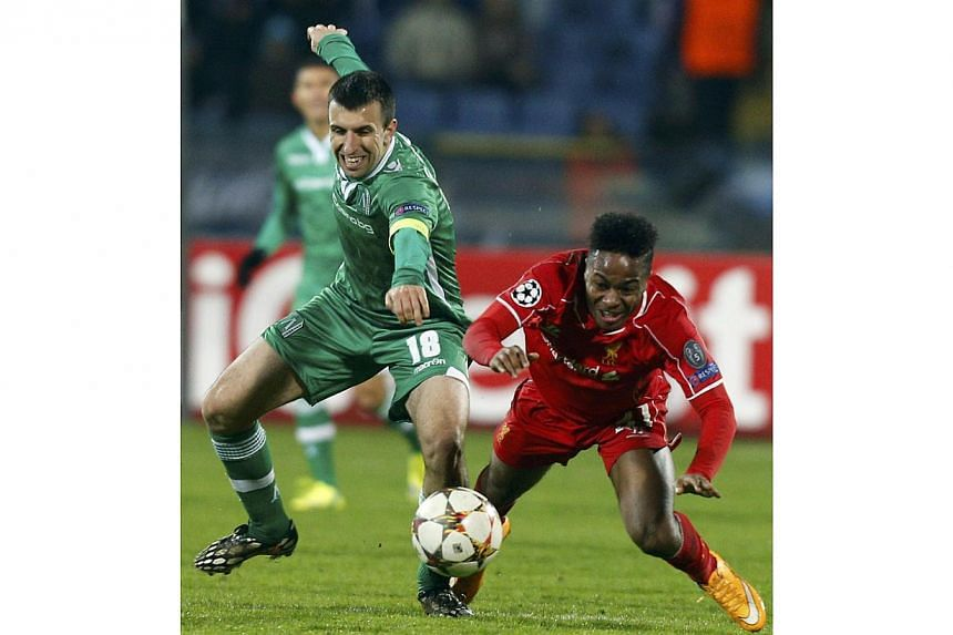 Raheem Sterling (right) of Liverpool is challenged by Svetoslav Dyakov of Ludogorets during their Champions League Group B match at Vassil Levski stadium in Sofia on Nov 26, 2014. -- PHOTO: REUTERS
