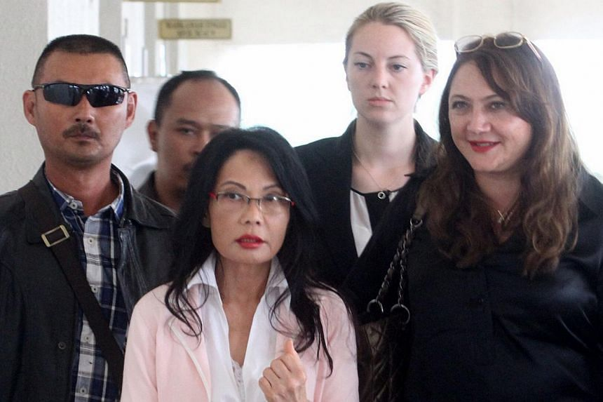 Tycoon Khoo Kay Peng has succeeded in establishing his case for the Malaysian court to hear his divorce proceedings against Pauline Chai Siew Phin (centre). -- PHOTO: THE STAR/ASIA NEWS NETWORK