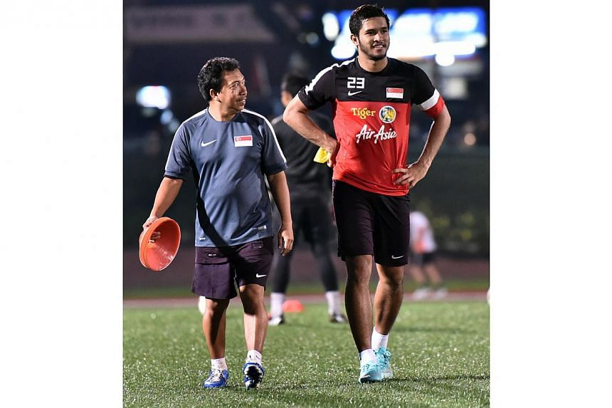 FAS kitman Omar Mohamed (left) with Zulfahmi Arifin at the national football team's centralized training session ahead of the Suzuki Cup, Nov 12, 2014. -- ST PHOTO: LIM YAOHUI