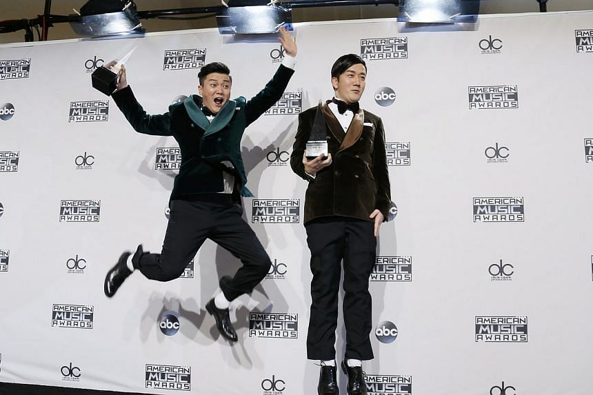 "The Chopstick Brothers pose backstage with their award for favorite international song for ""Little Apple"" during the 42nd American Music Awards in Los Angeles, California on Nov 23, 2014. -- PHOTO: REUTERS"