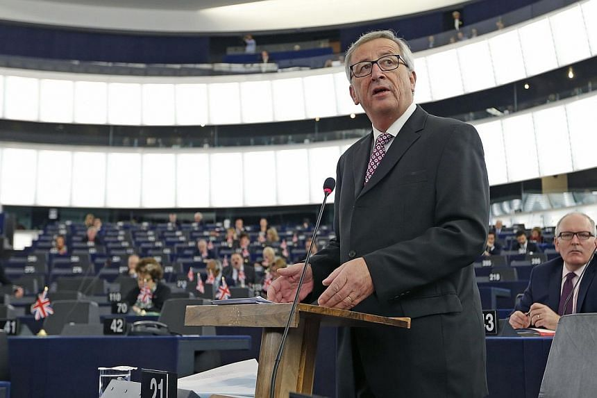 Commission President Jean-Claude Juncker said no final decisions on sanctions would be taken until March in order for governments to come up with concrete measures and clear timetables. -- PHOTO: REUTERS