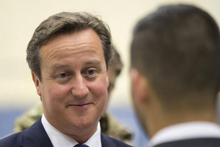 British PM David Cameron is set to announce a ban on EU migrants claiming welfare for four years. -- PHOTO: REUTERS