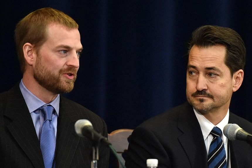 Recent Ebola survivor Dr. Kent Brantly (left) speaks about his experience as his colleague Dr. Lance Plyler listens during the Overseas Security Advisory Council (OSAC) annual meeting at the State Department in Washington, DC on Nov 19, 2014. Men who