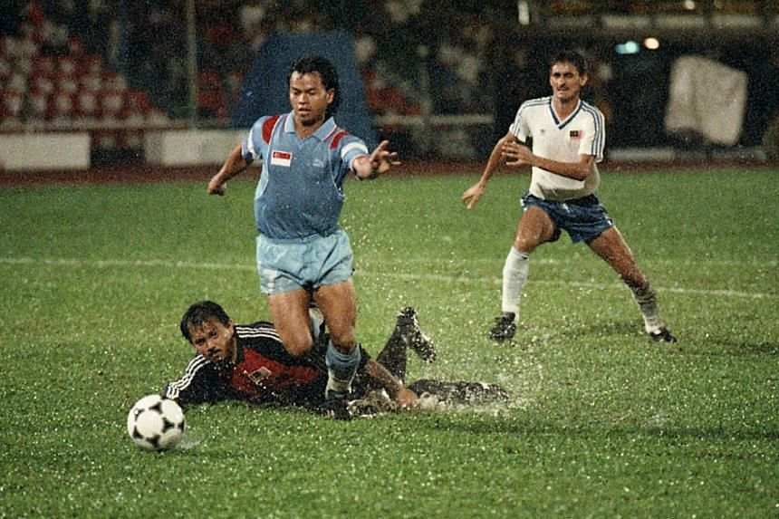 Singapore and Malaysia: 1989 SEA Games final. -- ST PHOTO: ALBERT SIM