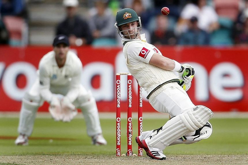 Australia's Phil Hughes avoids a high ball during the second cricket test match against New Zealand at Bellerive Oval in Hobart on Dec 11, 2011. Hughes, fatally struck by a ball on Tuesday, is our latest reminder of the perils confronting athletes. -