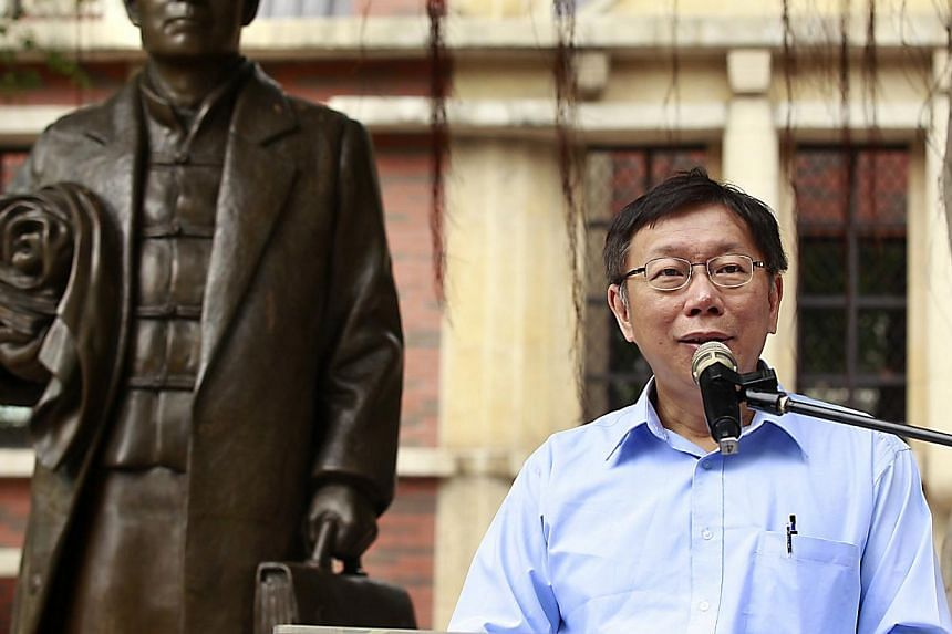 Taipei mayoral candidate Ko Wen-je gives a speech ahead of the local election in a park in Taipei on Nov 27, 2014.Dr Ko Wen-je, a top doctor who is leading the race to be Taiwan's next mayor, speaks to The Straits Times' Li Xueying on the city'