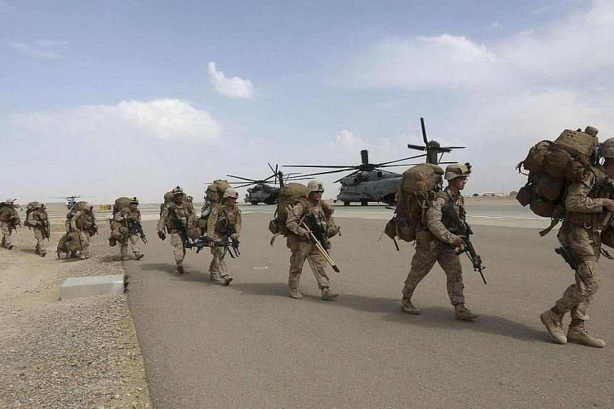 US Marines prepare to depart upon the end of operations for Marines and British combat troops in Helmand on Oct 27, 2014. Taleban insurgents have launched a prolonged attack on a major Afghan army base that was handed over by NATO forces last mo