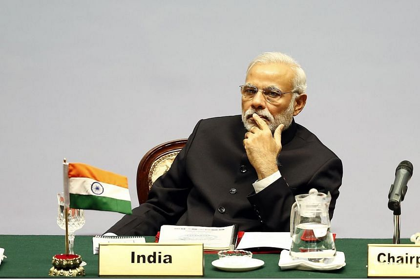 India's Prime Minister Narendra Modi looks on during the opening session of the 18th South Asian Association for Regional Cooperation (SAARC) summit in the Nepalese capital Kathmandu on Nov 26, 2014. India pledged a slew of regional investments at a