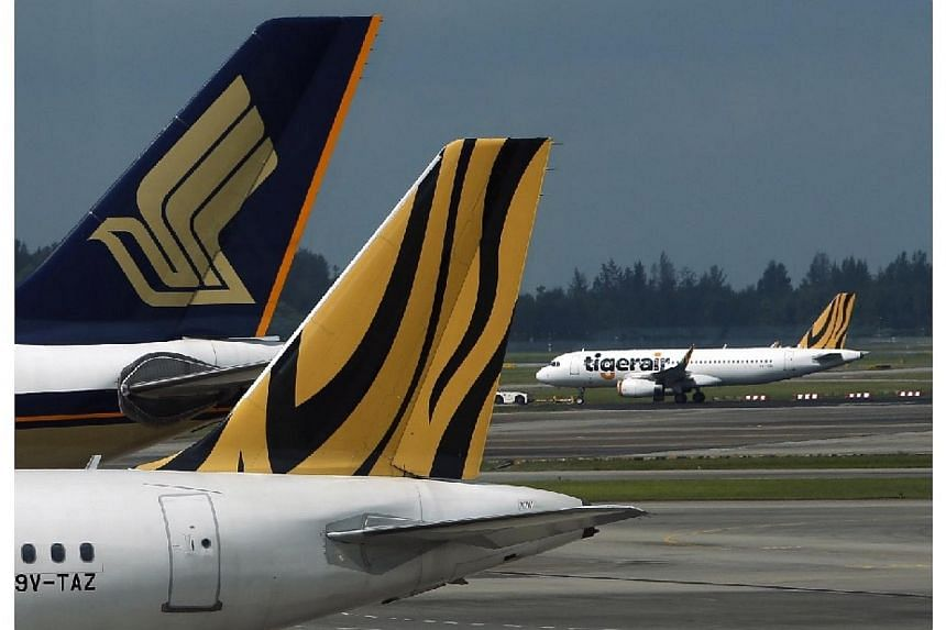 The Competition Commission of Singapore (CCS) has cleared the proposed acquisition of Tiger Airways Holdings by Singapore Airlines (SIA). -- PHOTO: REUTERS