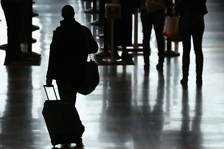 Police have arrested 118 people in an unprecedented globally-coordinated swoop on plane ticket credit card fraud, a billion-dollar organised crime industry, officials said Friday. -- PHOTO: AFP